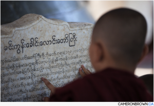 Cameron Brown photo of monk studying scriptures